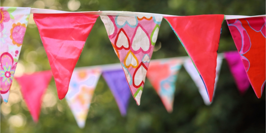 Brightly coloured bunting hanging up at outdoor event